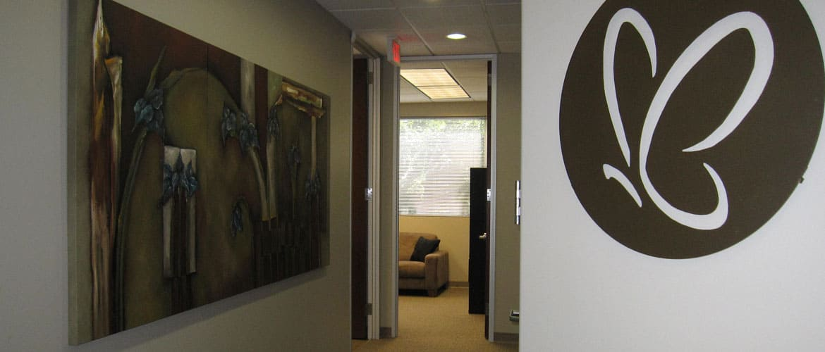 Hallway with Wall Painting - Shirley E. Cagle, DDS in The Woodlands