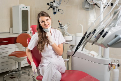 dental hygienist in dental chair